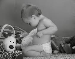 Baby gazing at navel